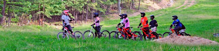 Guests taking a lesson at the Mountain Bike Park