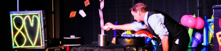 Magician makes cards fly out of a tin cup