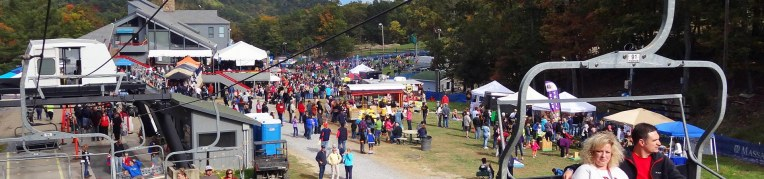 Families riding the scenic chairlift at the Fall Festival at Massanutten Resort