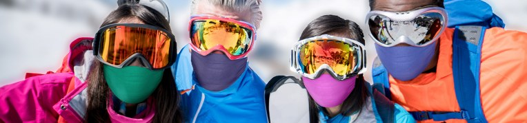 Guests in face masks enjoying snow sports