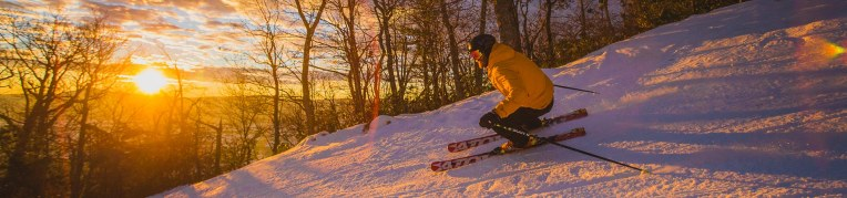 Skier on the Massanutten ski slopes during sunrise