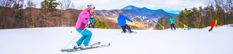 Two skiers and two snowboarders go down the Massanutten Ski Slopes
