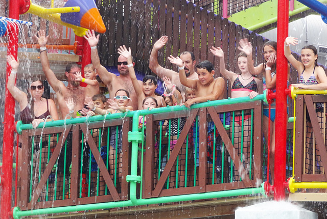 people wave from the waterpark