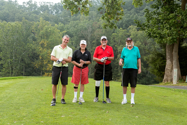golfers pose for a photo