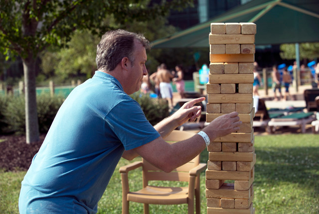man playing extra large jenga