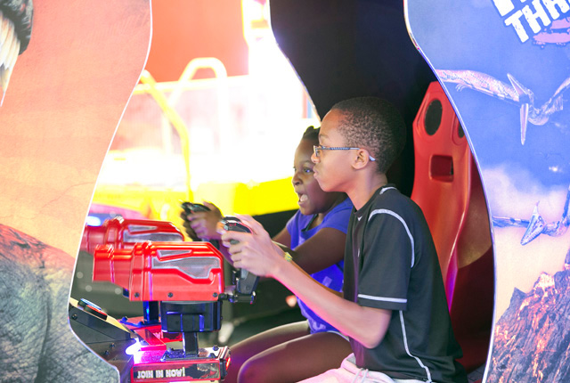 kids playing arcade game